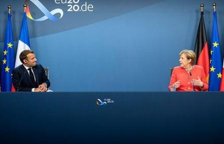 Bundeskanzlerin Merkel mit dem französischen Präsidenten Emmanuel Macron.
