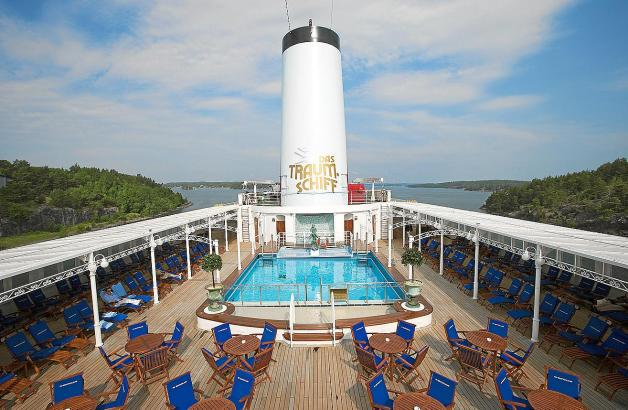 Pool deck of cruiseship MS Deutschland (Reederei Peter Deilmann) as vessel passes through narrow passage of Stockholm archipel