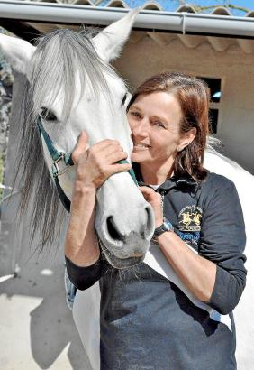 """Reitprofi Heike Rigbers mit einem ihrer Lieblingspferde, """"Neus""""."""