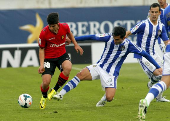Trotz Gegenwehr kann sich Mallorcas Youngster Marco Asensio hier am Ball behaupten.