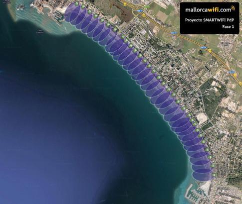 Die Aufnahme zeigt die Playa de Palma aus der Vogelperspektive. Die violette Fläche präsentiert die WLAN-Zone an Strand und Prom