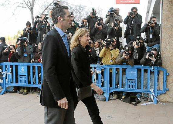 Spain's Princess Cristina arrives at court with her husband Inaki Urdangarin to attend trial in Palma de Mallorca