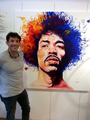 Badia Ferrer mit seinem Hendrix-Gemälde.