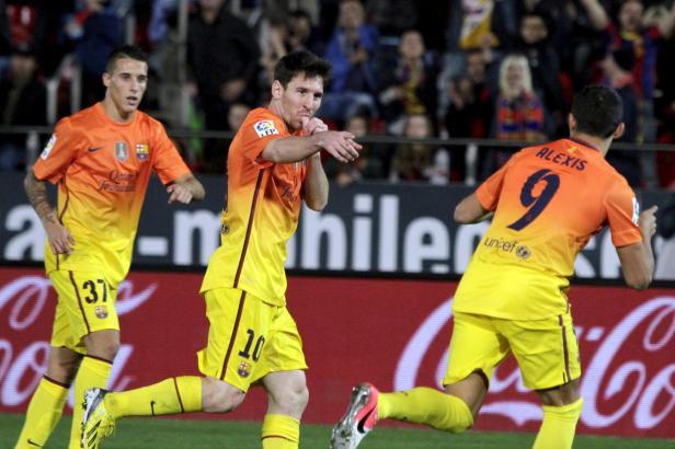 Lionel Messi (M.) bei einem seiner Auftritte mit dem FC Barcelona bei Real Mallorca.